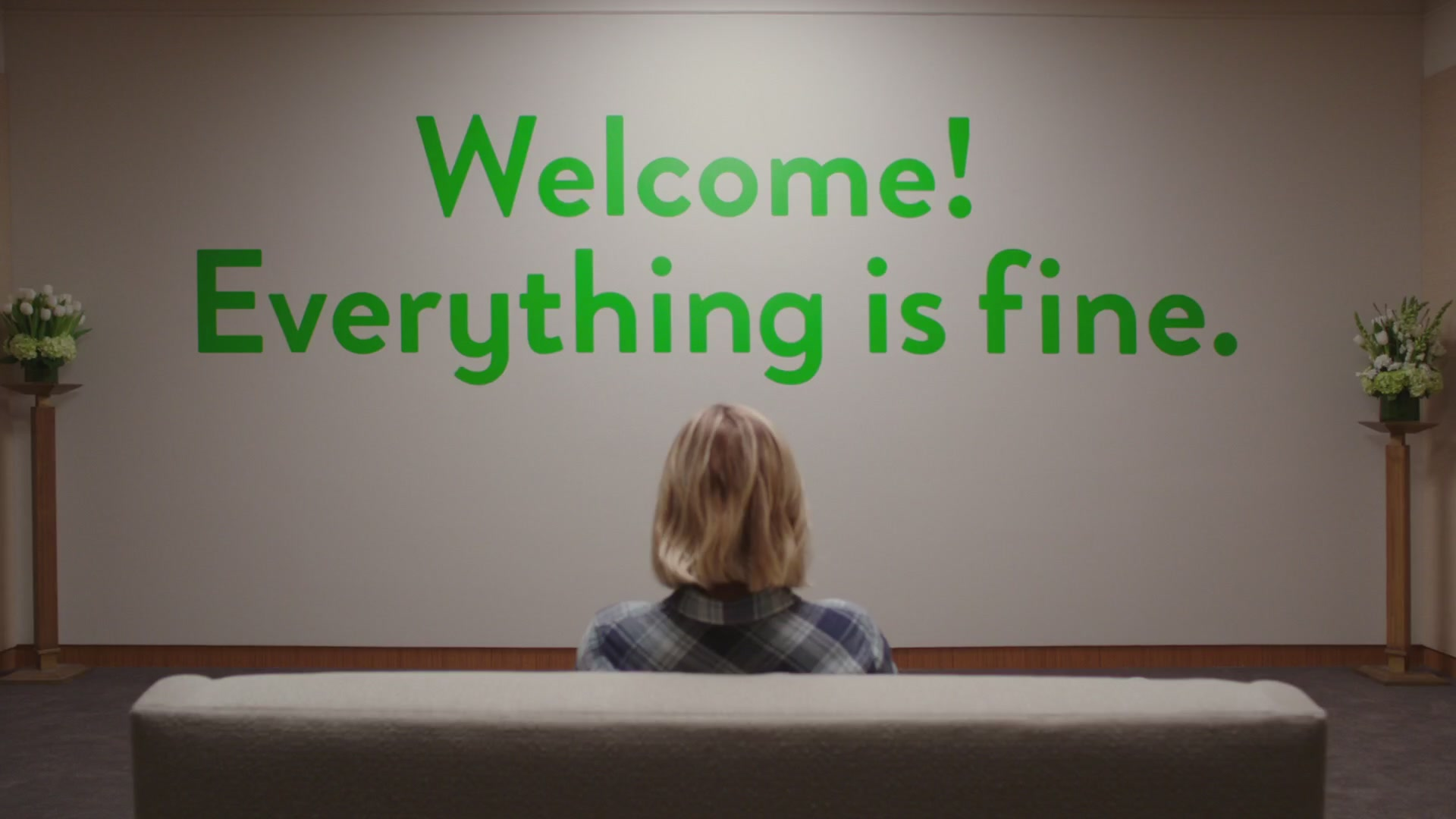Kristen Bell staring at sign Welcome! Everything is Fine in The Good Place