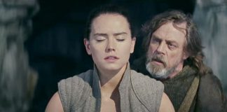 Luke Skywalker gazes in amazement at Rey in The Last Jedi