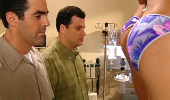 Jimmy Kimmel staring at a woman's butt